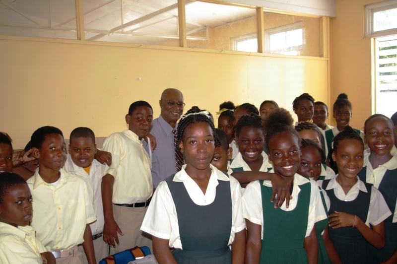 Premier, Hon. Joseph Parry with children of the Ivor Walters Primary School children