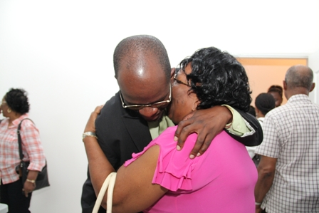 A female constituent shows tangible appreciation to Constituency Representative in the Federal Parliament, Attorney General and Minister of Legal Affairs Hon. Patrice Nisbett for ensuring the community centre became a reality