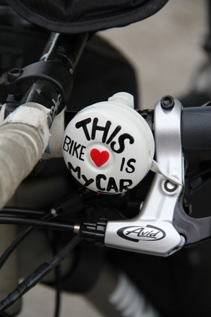 Ms. Kristina Storey's personalised button on her bike she will ride from Nevis on April 1st, 2012 for 30,000 kilometres for 300 days to 26 countries and six continents before returning to Nevis in February 2013