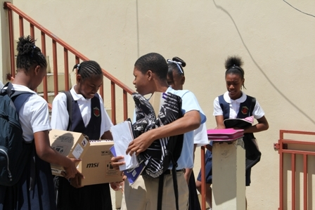 Happy Students at the Charlestown Secondary School walk away with their personal laptops from the One to One Laptop Project