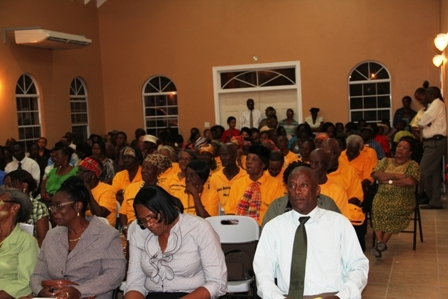 Cabinet Secretary in the Nevis Island Administration and Jessups Villager Mr. Ashley Farrell (first row extreme right) seated among those present at the official opening of the state of the art Jessups Community Centre