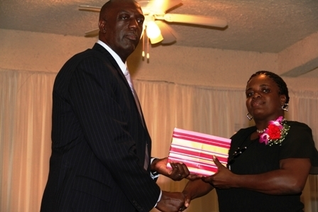 Third place out of nine nominees for the Constable of the year award Woman Police Constable Coretta Harris receives a gift from Police Commissioner Celvin G. Walwyn