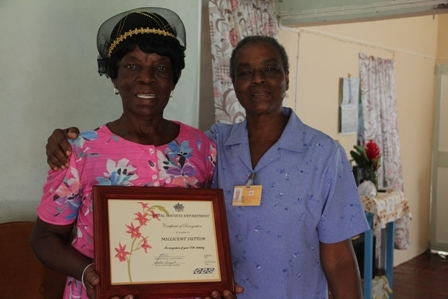 The Department of Social Services Care Giver for Cotton Ground and environs Mrs. Jeanette Herbert with Aunty Baby