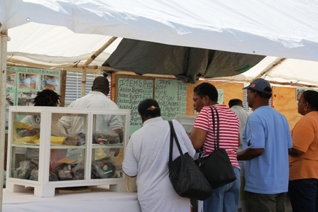 Members of the Nevis public patronise the Abattoir's stall at the 18th annual Department of Agriculture Open Day at the Villa Grounds in Charlestown