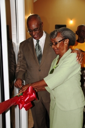 Premier of Nevis and Area Representative Hon. Joseph Parry and Jessups Villager Ms. Anita Byron cut the ribbon to signal the official opening of the Jessups Community Centre