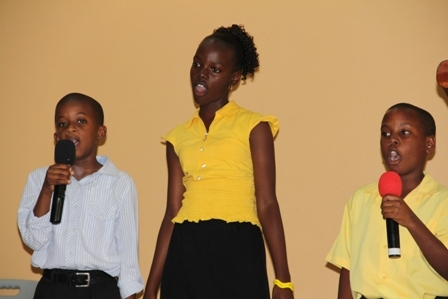 """Students from Jessups Village reciting a poem called """"Jessups Community"""" written by Mr. John Hanley"""