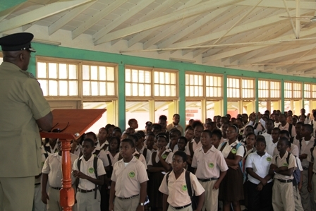 Form 1-5 students at the Gingerland Secondary School listen to Commissioner of Police in the Royal St. Christopher and Nevis Police Force Celvin G. Walwyn at the school's auditorium on Tuesday April 24, 2012