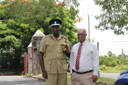Commissioner of Police in the Royal St. Christopher and Nevis Police Force Celvin G. Walwyn with Premier of Nevis Hon. Joseph Parry during a previous visit to Nevis (file photo)