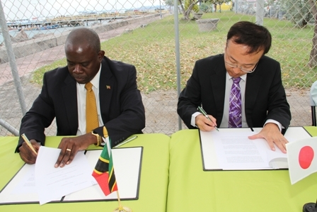 Minister of Agriculture and Fisheries in the Nevis Island Administration Hon. Robelto Hector (l) Chief Representative of Japan International Cooperative Agency (JAICA) Mr. Shoji Ozawa sign the grant agreement for the construction of the New Charlestown Community Fisheries Complex as witnesses. The agreement was signed moments before by Premier of Nevis and Minister of Finance Hon. Joseph Parry and Ambassador designate, Japan His Excellency Yoshimasa Tezuka