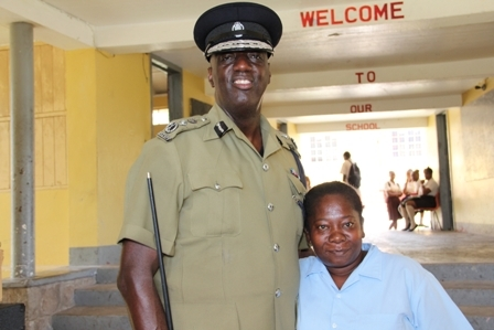 Commissioner of Police in the Royal St. Christopher and Nevis Police Force Celvin G. Walwyn (l) interacts with staff at the Gingerland Secondary School