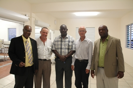 (L-R) Premier of Nevis Hon. Joseph Parry, Executive Chief and advisor for nutrition and menus in the Private Initiative for School Lunches group Mr. Mark Roberts, Area representative for the St. Pauls Parish Hon. Robelto Hector, lead members in the Private Initiative for School Lunches group Mr. James Gaskell and Mr. Hastings Daniel during a tour of the new Charlestown Primary School Cafeteria
