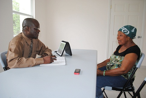 St. Kitts- Nevis Attorney General, Hon. Patrice Nisbett speaking with St. James Parish resident, Ms. Govania Butler