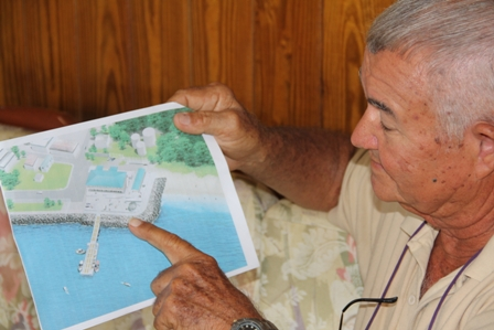 Former Director of Fisheries on Nevis Captain Arthur Anslyn looks approvingly at an artist's impression of the new Charlestown Community Fisheries Complex at Gallows Bay