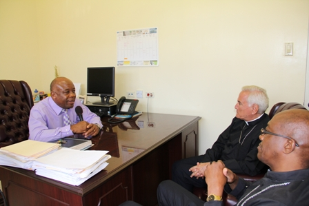 Acting Premier in the Nevis Island Administration Hon. Hensley and Vatican officials (l-r) Bishop of St. Johns/Basseterre the Most Reverend Kenneth Richards and new Vatican Ambassador to St. Kitts and Nevis the Most Reverend Nicola Girasol during a courtesy call at his Charlestown Office