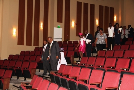 Prime Minister of St. Kitts and Nevis the Hon. Denzil Douglas and Premier of Nevis Hon. Joseph Parry followed by Mr. and Mrs. Sutton and family on a tour of the Michael Herald Sutton Auditorium