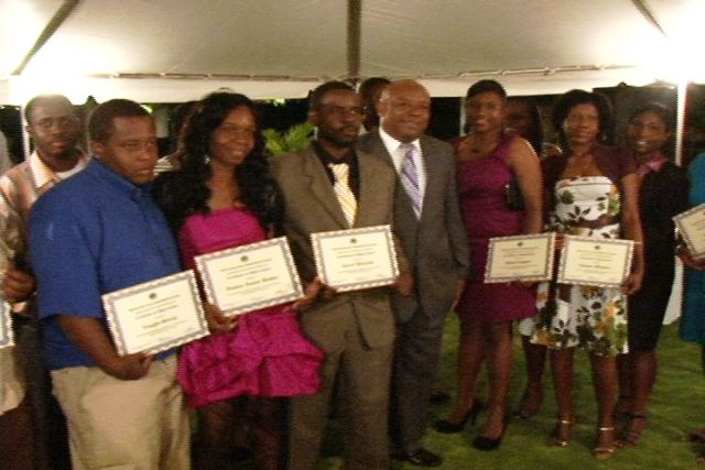 A section of the awardees at the Department of Human Resource's Award Ceremony for Young Civil Servants held at the Botanic Gardens, with (fourth from right) Deputy Premier and Minister responsible for Youth in the Nevis Island Administration Hon. Hensley Daniel