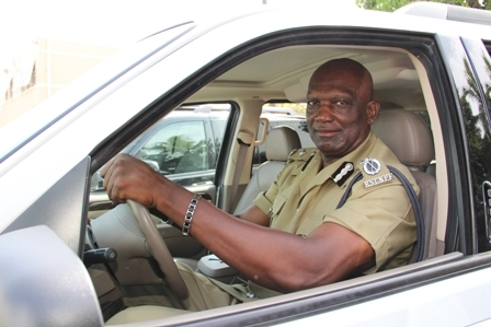 Assistant Commissioner of Police in charge of the Nevis Police Division Mr. Robert Liburd tests one of the three vehicles moments after he was given the keys to the vehicles by the Federation's Commissioner of Police Celvin G. Walwyn