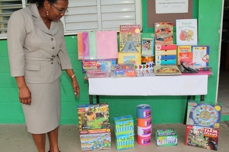 Principal of the Joycelyn Liburd Primary School Mrs. Marion Lescott showing off some of the most recent supplies purchased for her Kindergarten class from fund raising efforts by students of the Glen Urquhart School (GUS) in Massachusetts, USA