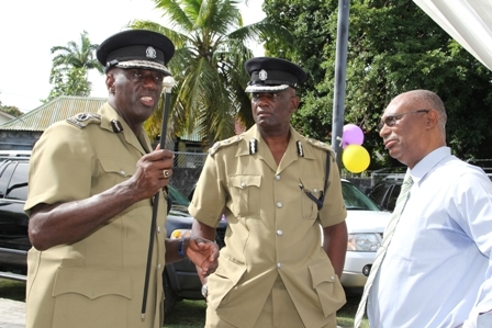 (L-R) Commissioner of Police in Si. Kitts and Nevis Mr. Celvin G. Walwyn with Assistant Commissioner in charge of the Nevis Division Robert Liburd and Premier of Nevis Hon. Joseph Parry in conversation near the three donated vehicles at the end of the handing over ceremony