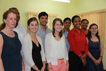 Research students from the University of Virginia with (first row extreme left) Faculty member at the Virginia School of Nursing and member of the School's Dissertation Committee Ms. Audrey Snyder. (Back row extreme left) Team leader and Professor of Emergency Medicine; Vice President and Chief for Diversity and Equity at the University Dr. Marcus Martin (front row second from right) Health Planner in the Ministry of Health on Nevis Mrs. Nicole Slack-Liburd and (back row extreme right) PhD student of the University of Virginia, School of Nursing Ms. Jamela Martin at the Ministry of Health's Conference, Nevis Island Administration Building in Charlestown