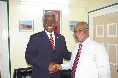 (L-R) United States Ambassador His Excellency, Larry L. Palmer meeting with Premier of Nevis, Hon. Joseph Parry