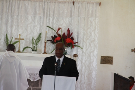 Premier of Nevis, Hon. J. Parry delivering a tribute during the funeral