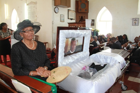Widow of Dr. Daniel, Mrs. Sheila Daniel beside Dr. Simeon Daniels Coffin