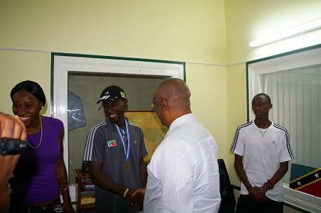 Premier, Hon. Joseph Parry congratulating Mr. Adrian Williams, gold medalist