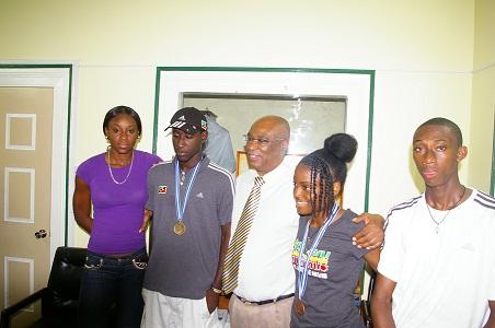 Premier of Nevis, Hon. Joseph Parry with the Nevisian Athletes, Brittany Morton,Adrian Williams,Renika Daniel and Izaun Ward