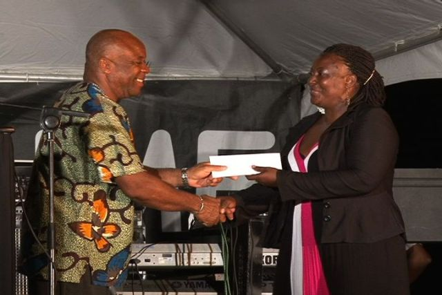 Culturama 2012 slogan winner Ms. Jean Caines receives award from Minister of Culture on Nevis Hon. Hensley Daniel
