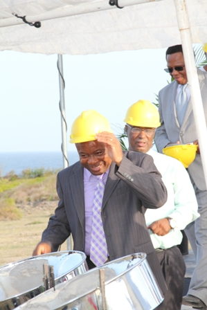 A happy moment for Nevis Island Administration officials (Hon. Hensley Daniel followed by Premier of Nevis Hon. Joseph Parry with hard hats on, moments before breaking ground for the New River Medical Centre. Following them is Chief Executive Officer of the Princeton Health Care Incorporated based in Atlanta Mr. Don Williams