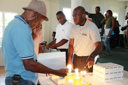 Persons enquire about energy saving devices at the exposition at the Occasions Conference Centre at Pinneys on Nevis