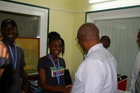 Premier of Nevis, Hon. Joseph Parry congratulating Miss Renika Daniel, bronze medalist