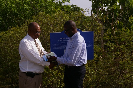 Premier of Nevis, Hon. Joseph Parry receiving cheque from CEO of SIDF-Mr. Terrance Crossman
