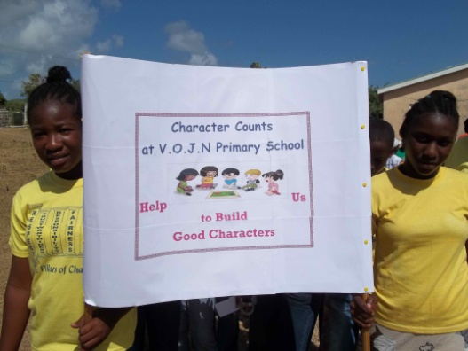 Children holding sign for Character Counts Walk- a-thon