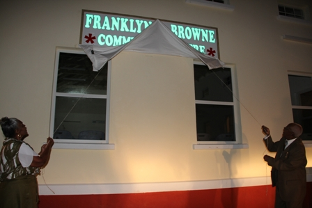 Mr. Franklyn Brown accompanied by his wife Lorraine unveil the new name of the Combermere Community Centre named in his honour