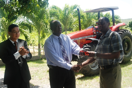 Minister of Agriculture in the Nevis Island Administration Hon. Robelto Hector (middle) hands over the keys of a new Massey Ferguson tractor, moments he received it from Republic of China/Taiwan's resident Ambassador to the Federation His Excellency Ambassador Miguel Tsao, to Permanent Secretary in the Ministry of Agriculture Dr. Kelvin Daly at the Taiwan Mission in Cades Bay, Nevis while Ambassador Tsao looks on