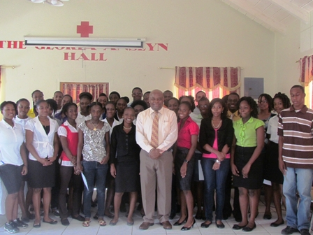 Successful interns of the of 2012 Summer Job Attachment Programme at the closing ceremony with then Minister of Social Development and Youth Hon. Hensley Daniel at the annual programme's closing ceremony at the Red Cross conference Room in Charlestown