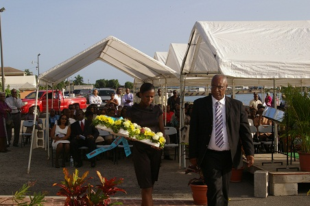 Premier Parry and Protocol officer Miss Dominique Honders placing wreath at Christena memorial