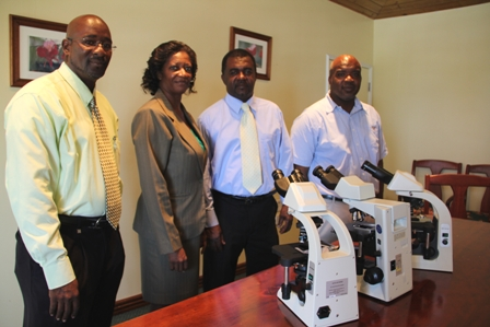 (L-R) Pastor of the Charlestown Seven Day Adventist Church Jerry Languedoc, Permanent Secretary in the Ministry of Health Ms. Angelica Elliott, Acting Hospital Administrator Mr. Johnson Morton and Medical Lab Supervisor Mr. Clester Roberts
