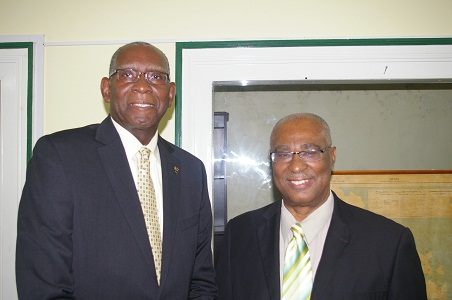 (L- R) UVI President, Dr. David Hall and Premier of Nevis, Hon. Joseph Parry at the Premiers Bath Hotel Office