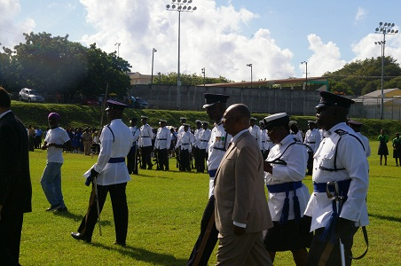 Premier of Nevis, Hon. Joseph Parry inspecting the uniformed bodies