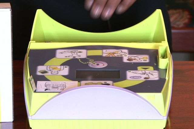 A close up of the portable defibrillator donated by Mrs. Joan Broadbelt Robinson on behalf of the Broadbelt, Queeley and Welcome families, in memory of seven year old Keyon Welcome who passed away under tragic circumstances on Nevis just over a year ago. It will be located in the Hospital's mobile emergency units
