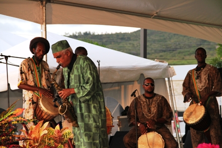 Jazz Saxophonist Mr. Lloyd Williams performs accompanied by Nevisian drummers on African drums at the official opening ceremony of the Nevis Performing Arts Centre on April 28, 2012