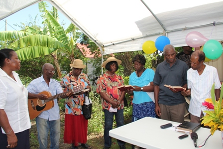 Mr. Melford Ward (extreme right) son of birthday celebrant Mrs. Selina Ward and other well wishers singing in celebration of his mother's 101st birthday