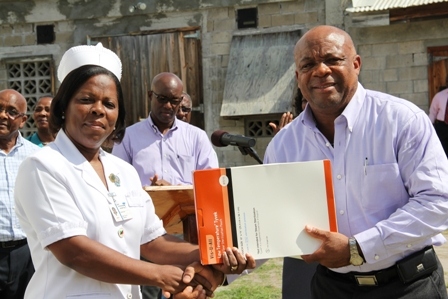 (L-R) Head Nurse at the Alexandra Hospital Matron Aldris Dias receives gift donated by the Hackettstown Medical Centre and Hackettstown Rotary Club in New Jersey through St. Kitts Rotary Club from Advisor to Health in the Nevis island Administration Mr. Hensley Daniel