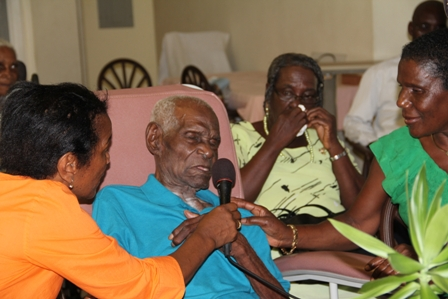 (L-R) Daughters Mrs. Helen Webbe and Mrs. Esther Sutton and their father Mr. Arnold Chiverton (middle) a 98 year old resident of the Flamboyant Nursing Home