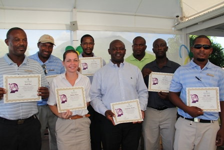 Eight supervisors at the Four Seasons Resort, Nevis showing off their graduation certificate from in-house training at the 10-week STEPS programme. (L-R front row) Stewarding Supervisor Mr. Cecil Dore, Front Office Supervisor Ms. Melanie Dupre, Safety and Loss Prevention Supervisor Mr. Livingston Brown, Audio Visual Supervisor Mr. Carl Tyson and Resort Landscaping Supervisor Mr. Kyle Mills. (L-R back row) Villa Landscaping Supervisor Mr. Alanzo David, Purchasing Supervisor Mr. Ignacio Ottley and Golf Course Supervisor Mr. Nigel Powell