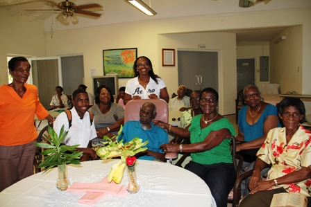 A family member smiles with birthday boy Mr. Arnold Chiverton of Beach Road