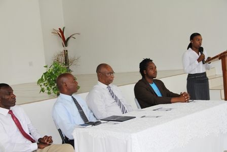 Head table at the Creativity for Employment and Business Opportunity Youth Training Workshop (l-r) Pastor Eversley Pemberton, Permanent Secretary in the Ministry of Social Development and Youth on Nevis Mr. Alsted Pemberton, Premier of Nevis and Minister of Social development and Youth Hon. Joseph Parry and Senior Youth Officer in the Department of Youth Empowerment in St. Kitts Mr. Pierre Liburd. Youth Coordinator in Nevis Mrs. Diane Pemberton is at the podium